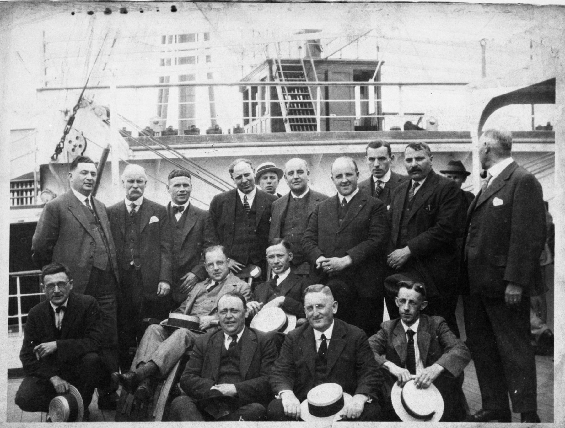 Steamship agents on board a passenger liner, ca. 1920. Included in this photo are local agents Henry Dworkin, Joseph Graner, and H. N. Sivitz.   OJA, item 6083.