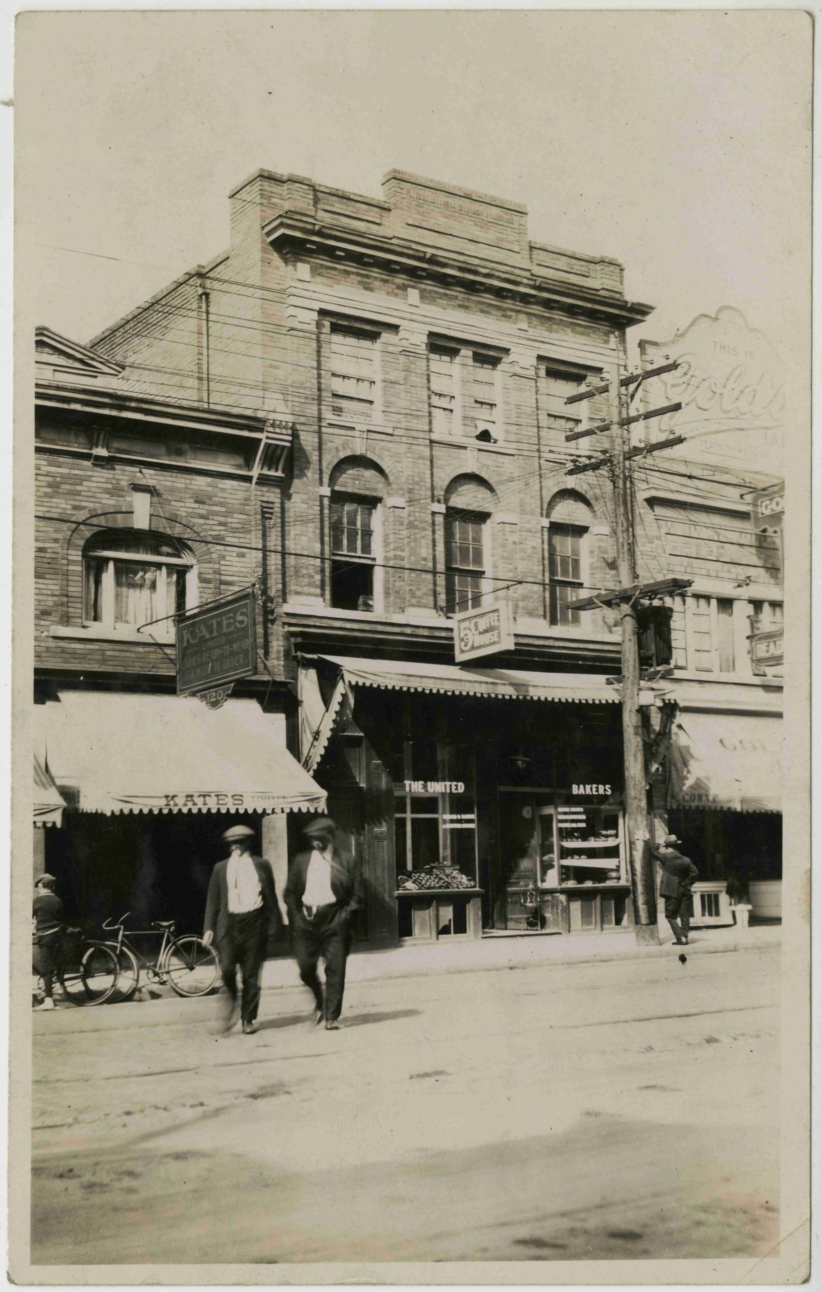 Dundas Street just west of Bay Street, ca. 1915. Back then Dundas Street was known as Agnes Street and Bay Street was known as Terauley Street. In this photograph you can see the storefront windows for the first location of United Bakers at 156 Agnes Street.    OJA, fonds 27, series 4, file 2.