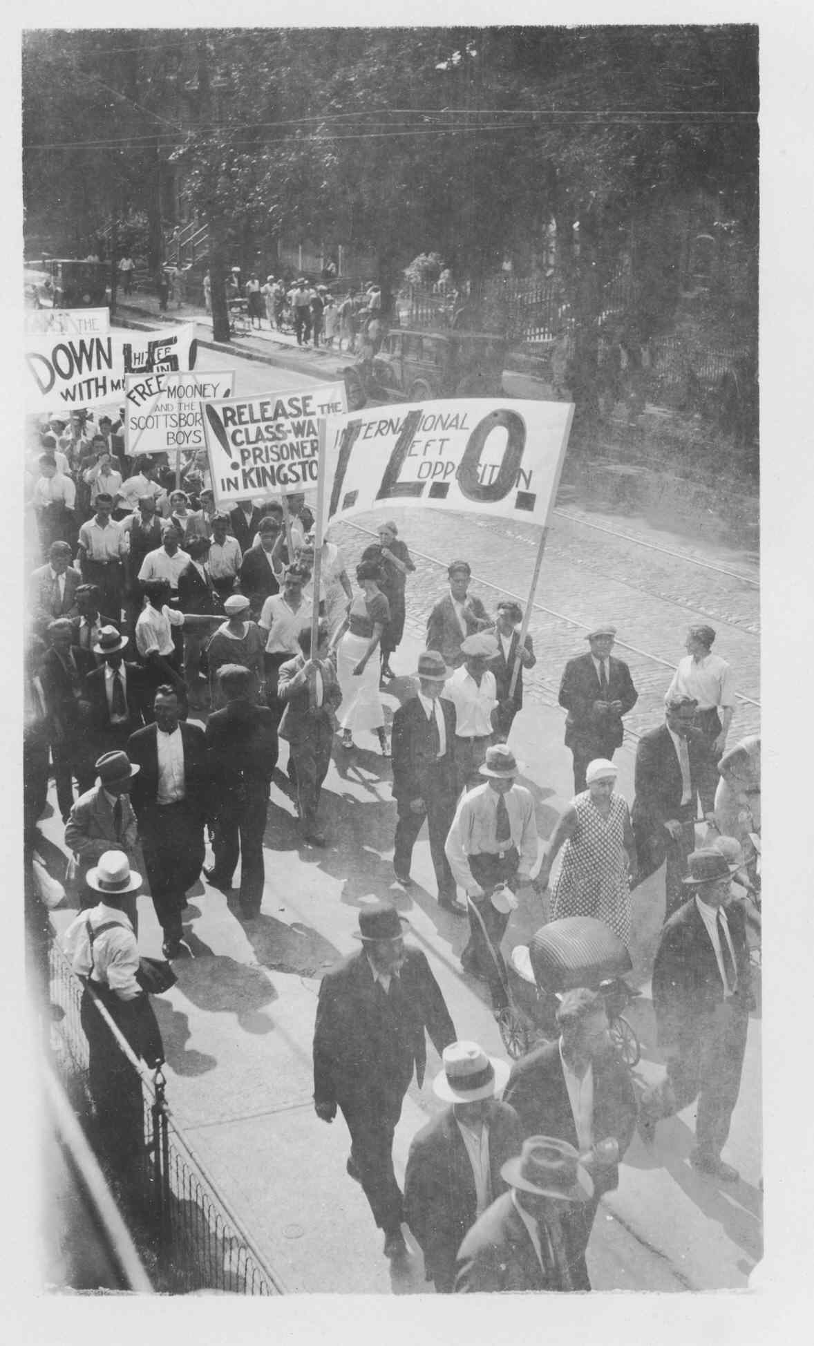 Overhead photograph of the International Left Opposition demonstration which took place on 11 July 1933. Over 15,000 people (mostly Jewish) walked off the job to protest Nazism, fascism, and other human rights issues. It was reported in the Globe and Mail as the largest protest of its kind in Canada since the 1919 Winnipeg strike.   OJA, fonds 32, item 6.