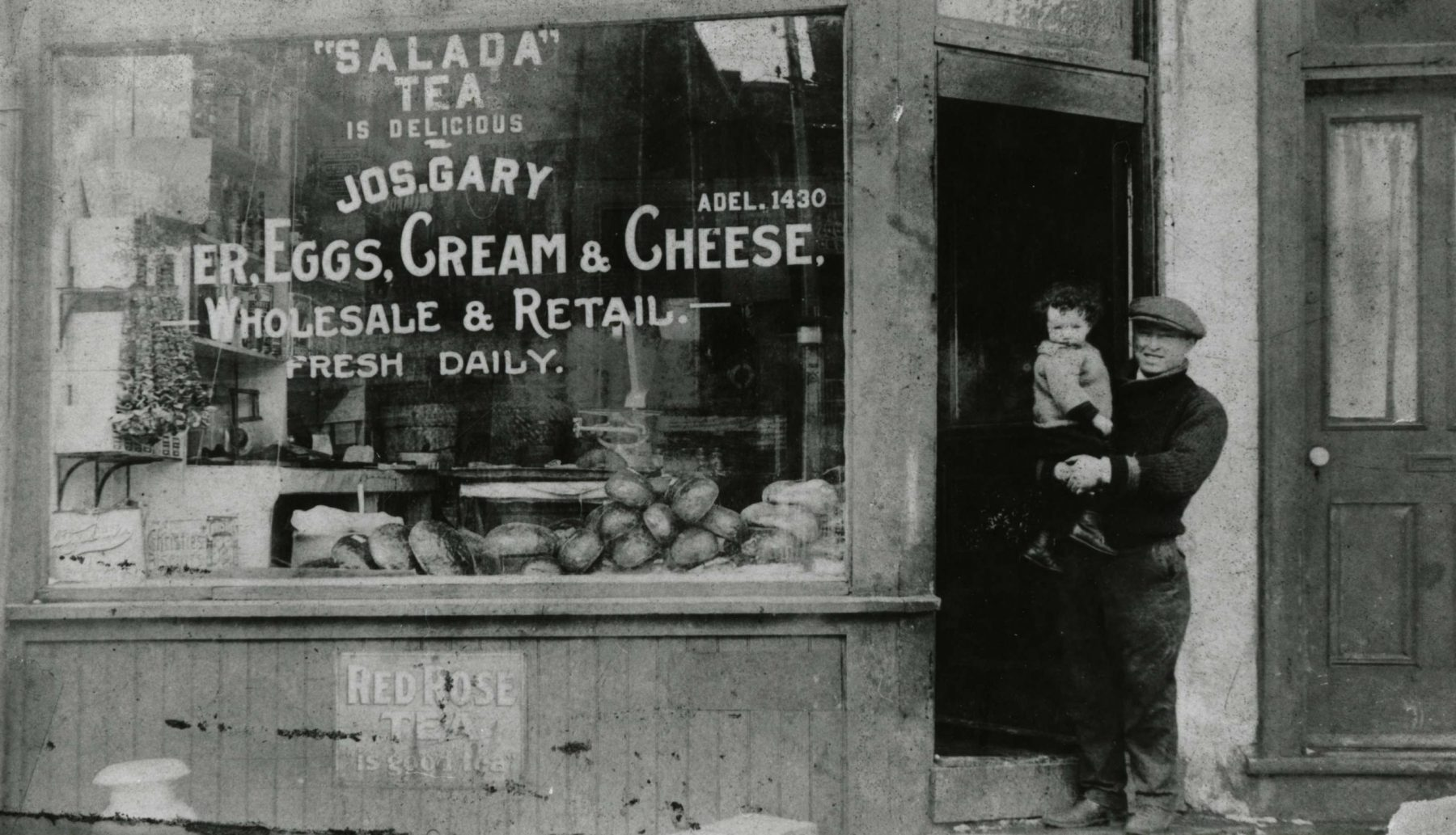 Joseph Gary in front of his grocery store at 136 Elizabeth Street in the Ward, ca. 1925.  The area was home to many retail shops, synagogues, and Toronto's Old City Hall. The neighbourhood was eventually levelled to make way for hospitals, Toronto's New City Hall, and Nathan Phillips Square.   OJA, item 1542.