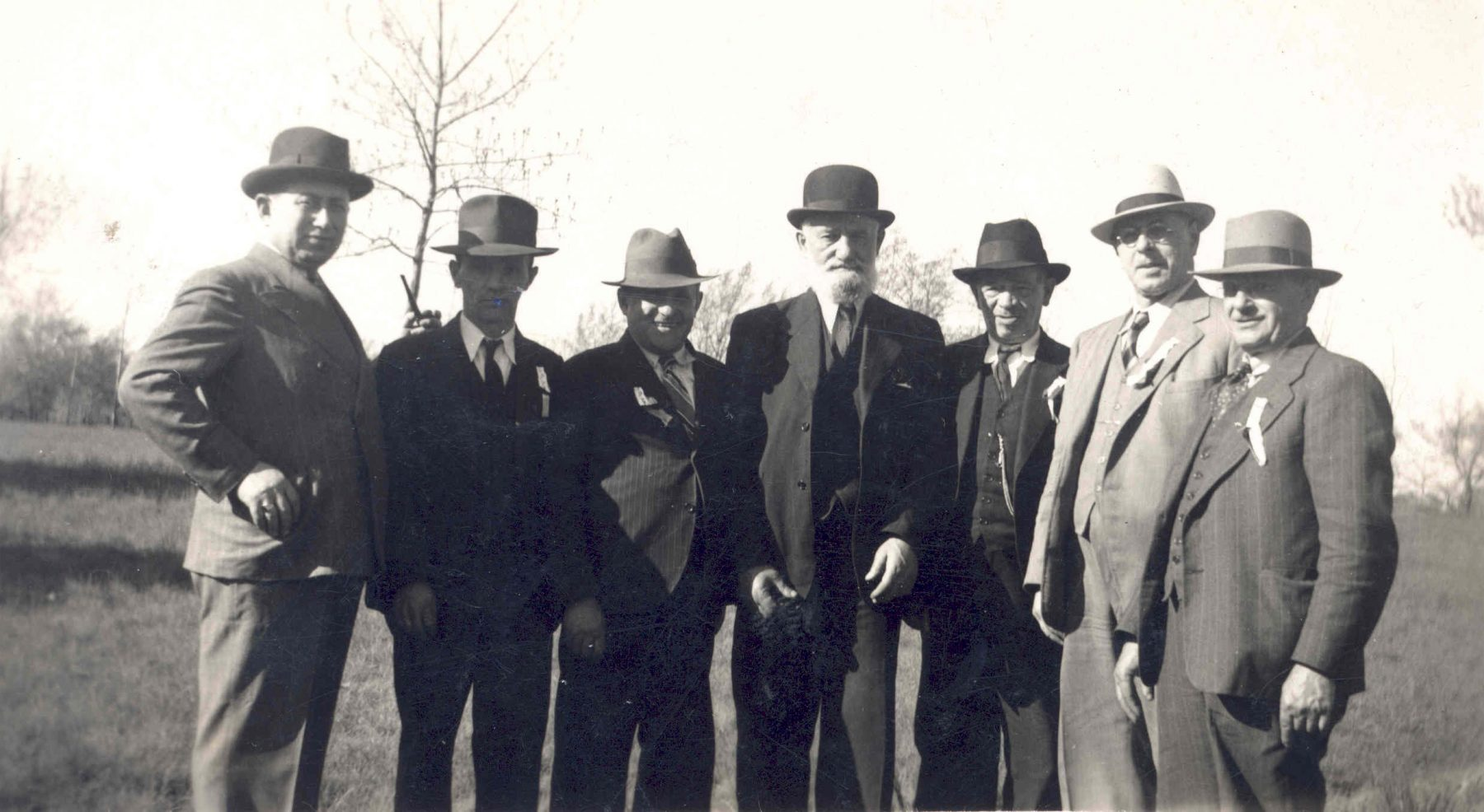 Members of the Kiever Shul in Toronto, ca. 1941. Individuals identified in the photograph are Harry Trachter, Fischel Cooper, and Israel Sakowick. Harry Trachter was the owner of Trachter's Milk Store, first located at 71 Kensington Avenue in 1925, and then just outside of the market at 800 Dundas Street West.   OJA, item 1437.