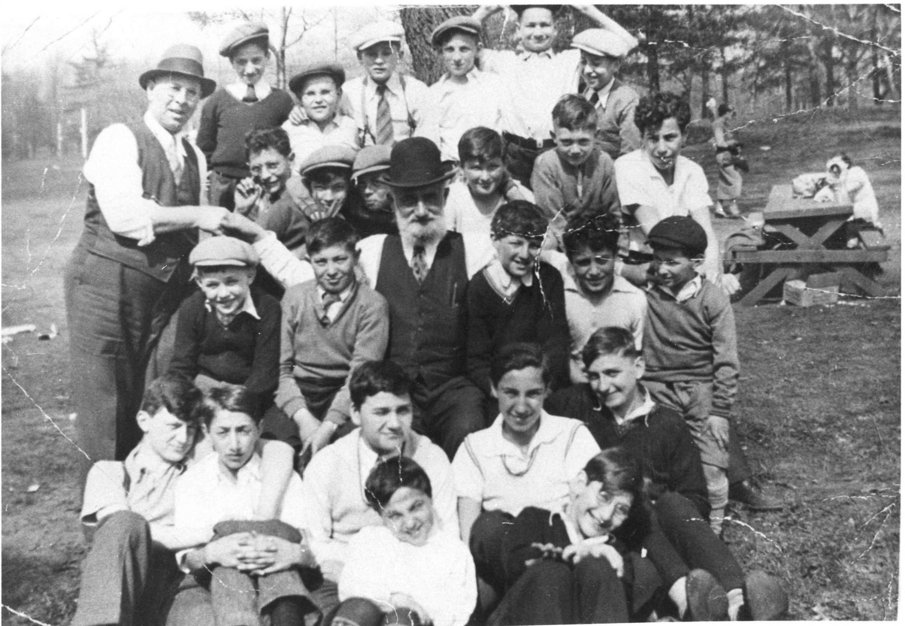 A group of boys pictured with Fischel Cooper, High Park, [between 1935 and 1939]. Fischel Cooper made important contributions to synagogue life at the Kiever Shul. He led the youth congregation and often took members on outings to Queen's Park and High Park.   OJA, item 18.