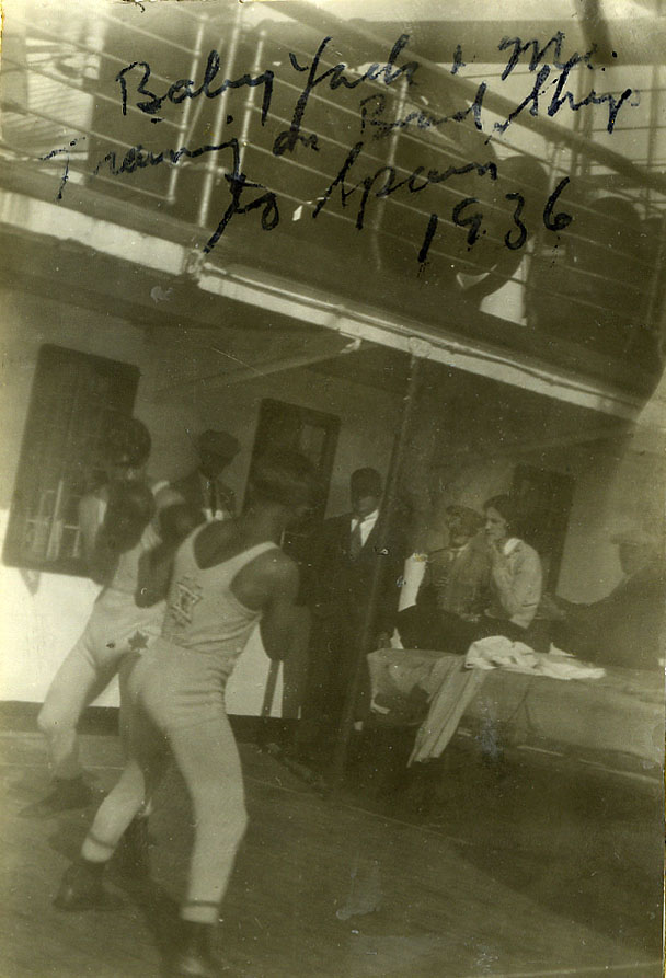 """Sammy Luftspring and Benjamin Norman """"Baby Yack"""" Yakubowitz in a casual boxing match aboard the SS Alaunia on route to the People's Olympics in Barcelona in 1936. As an amateur bantamweight boxer Norman """"Baby Yack"""" won over ninety of one hundred fights. Later in 1936, he turned professional and became the fourth ranked bantamweight in the world.   OJA, fonds 82, item 15."""