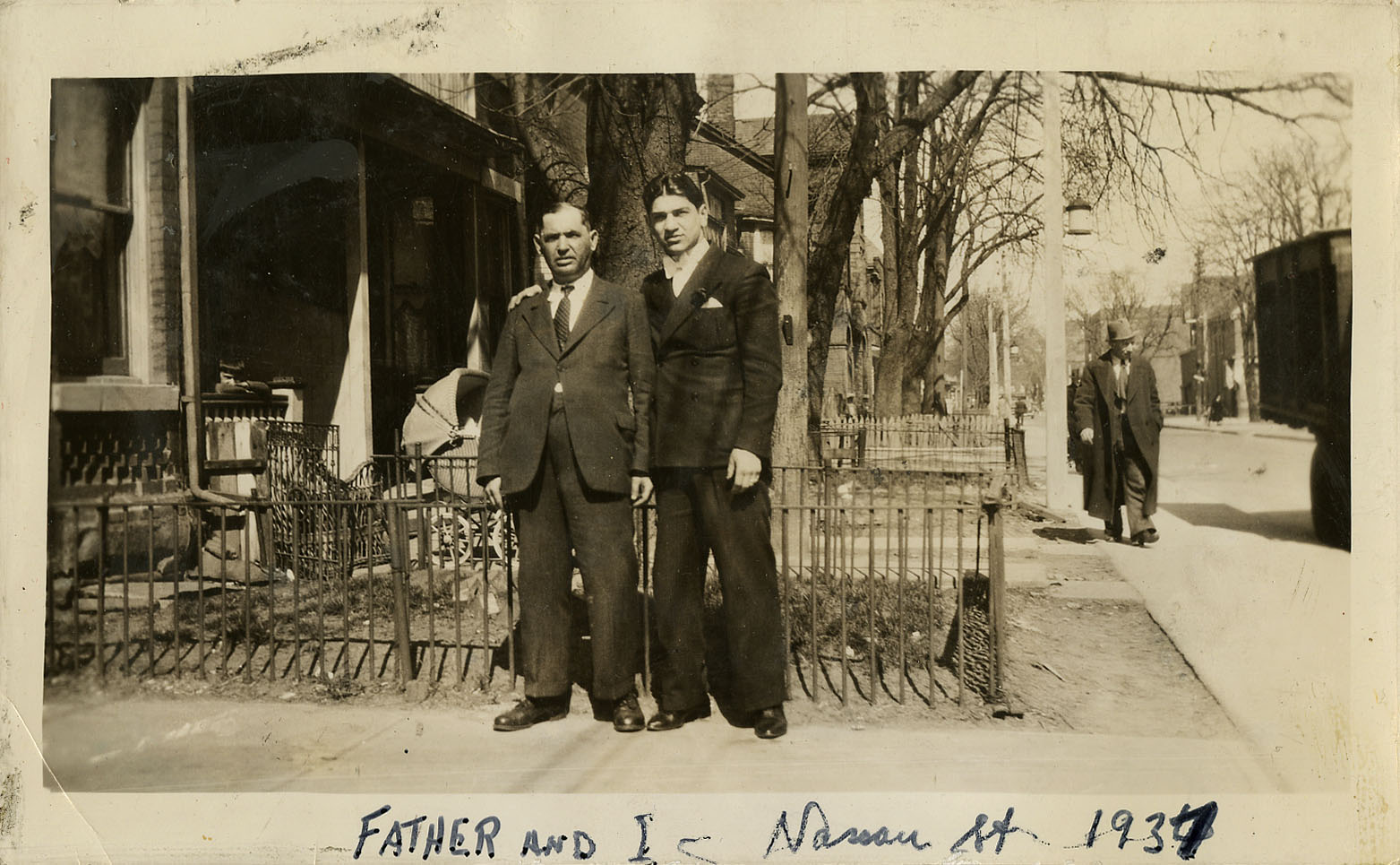 Sammy Luftspring with his father, Yossel Luftspring, outside of the family home on Nassau Street, in 1937.   OJA, fonds 82, item 18.