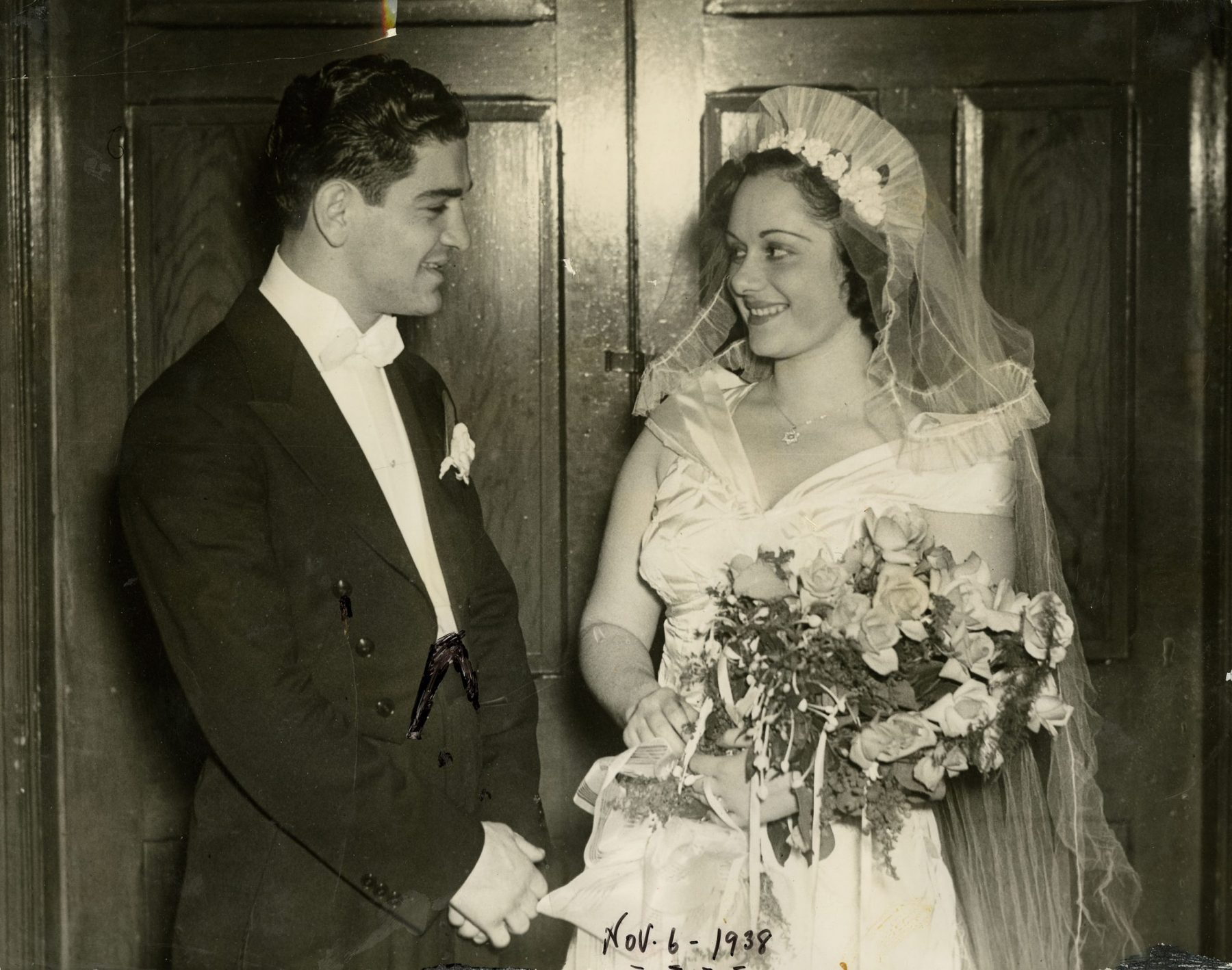 Wedding photograph of Elsie and Sammy Luftspring taken on 6 November 1938 at the McCaul Street Synagogue (Beth Hamidrash Hagadol). Three-hundred-and-fifty people attended his wedding, and hundreds waited outside of the synagogue to see the newlyweds.   OJA, fonds 82, item 20.