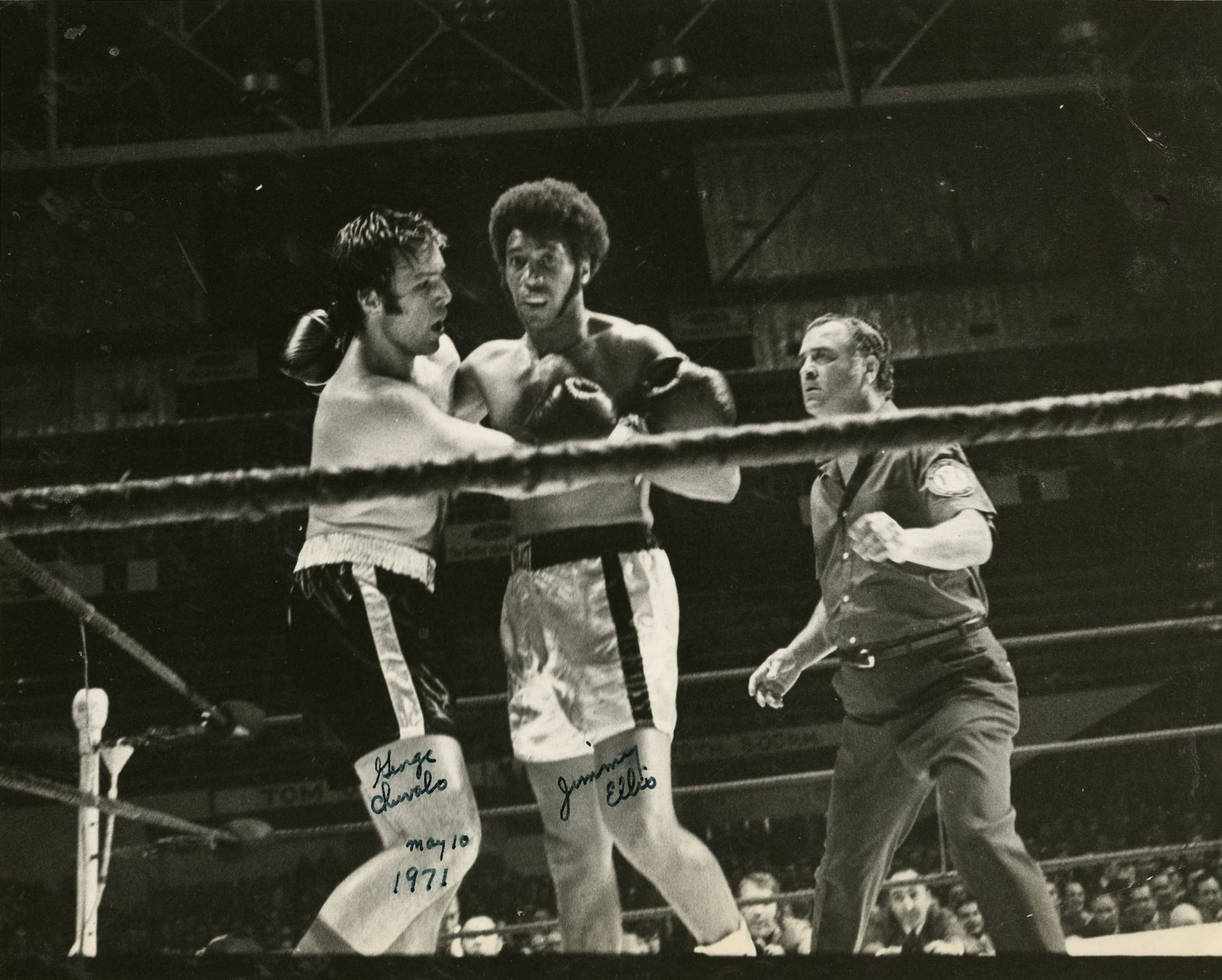 Sammy Luftspring refereeing a fight between George Chuvalo, a Canadian professional boxer and heavyweight champion, and Jimmy Ellis, an American professional boxer. The fight took place on 10 May 1971 at Maple Leaf Gardens.   OJA, fonds 82, item 30.