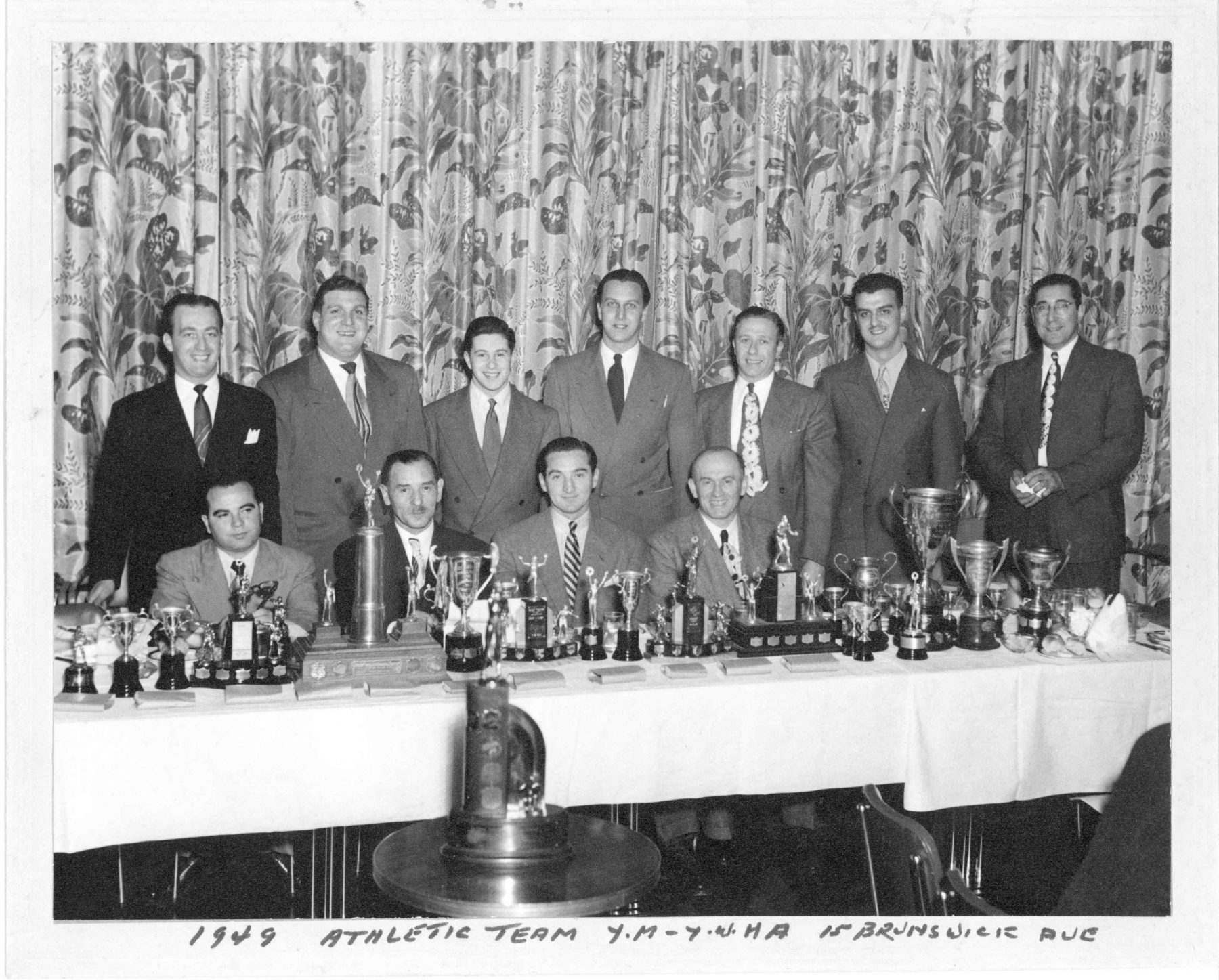 """1949 athletic awards banquet at the YM-YWHA building at 15 Brunswick Avenue. The banquet was held in 1950 to honour the """"Y"""" members for their athletic achievements during 1949.The YM-YWHA building facilities accommodated a wide range of sports. The athletic programs were robust and well organized, and an athletic membership only cost approximately twenty-five dollars per year.   OJA, item 3412."""