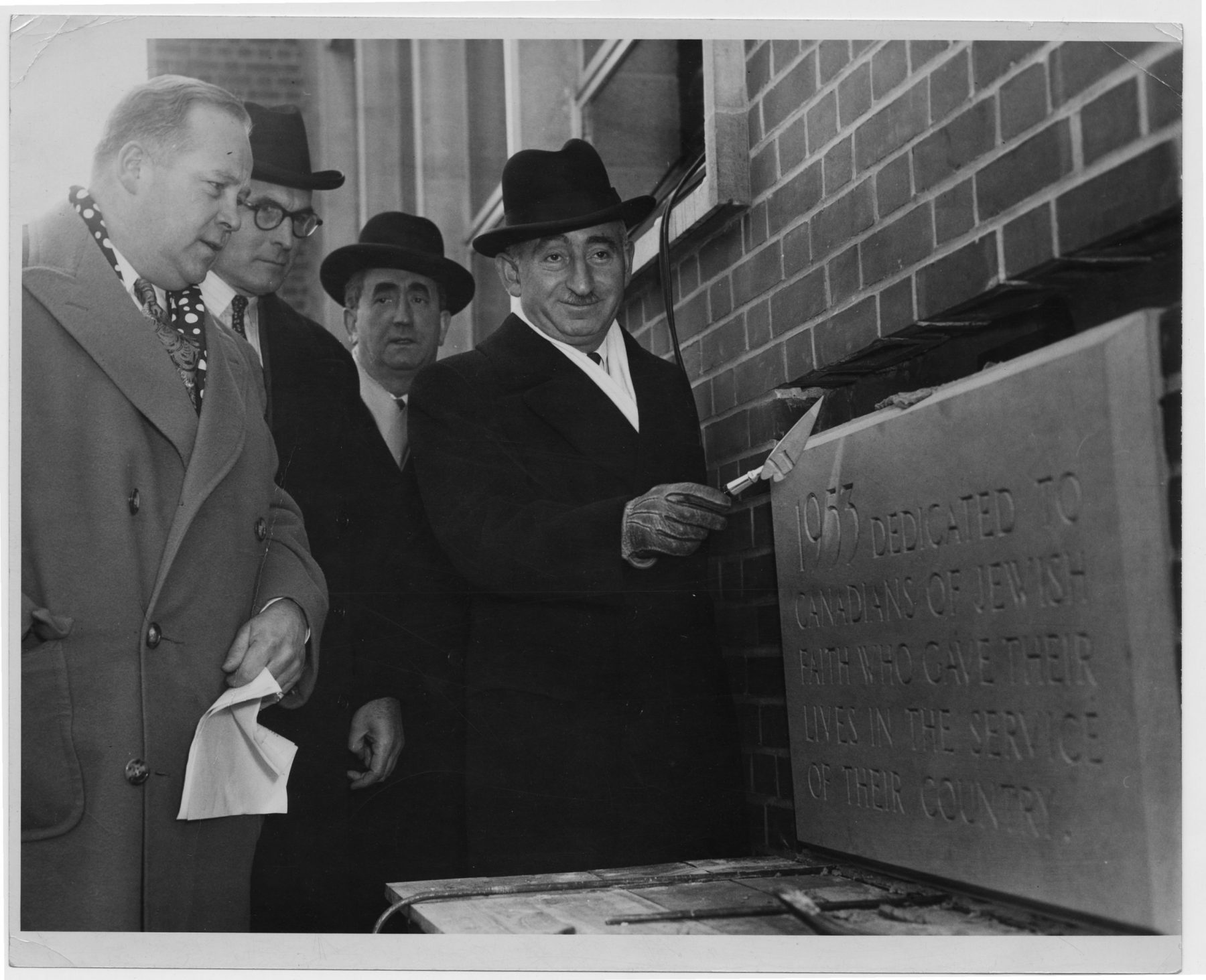 """The cornerstone dedication ceremony for the Bloor and Spadina YM-YWHA branch, held on 3 February 1953. By the end of the 1950s, the """"Y"""" provided programming and services for all ages, and after moving to this new building the organization expanded its non-athletic programming.   OJA, fonds 61, series 2-2, file 38."""