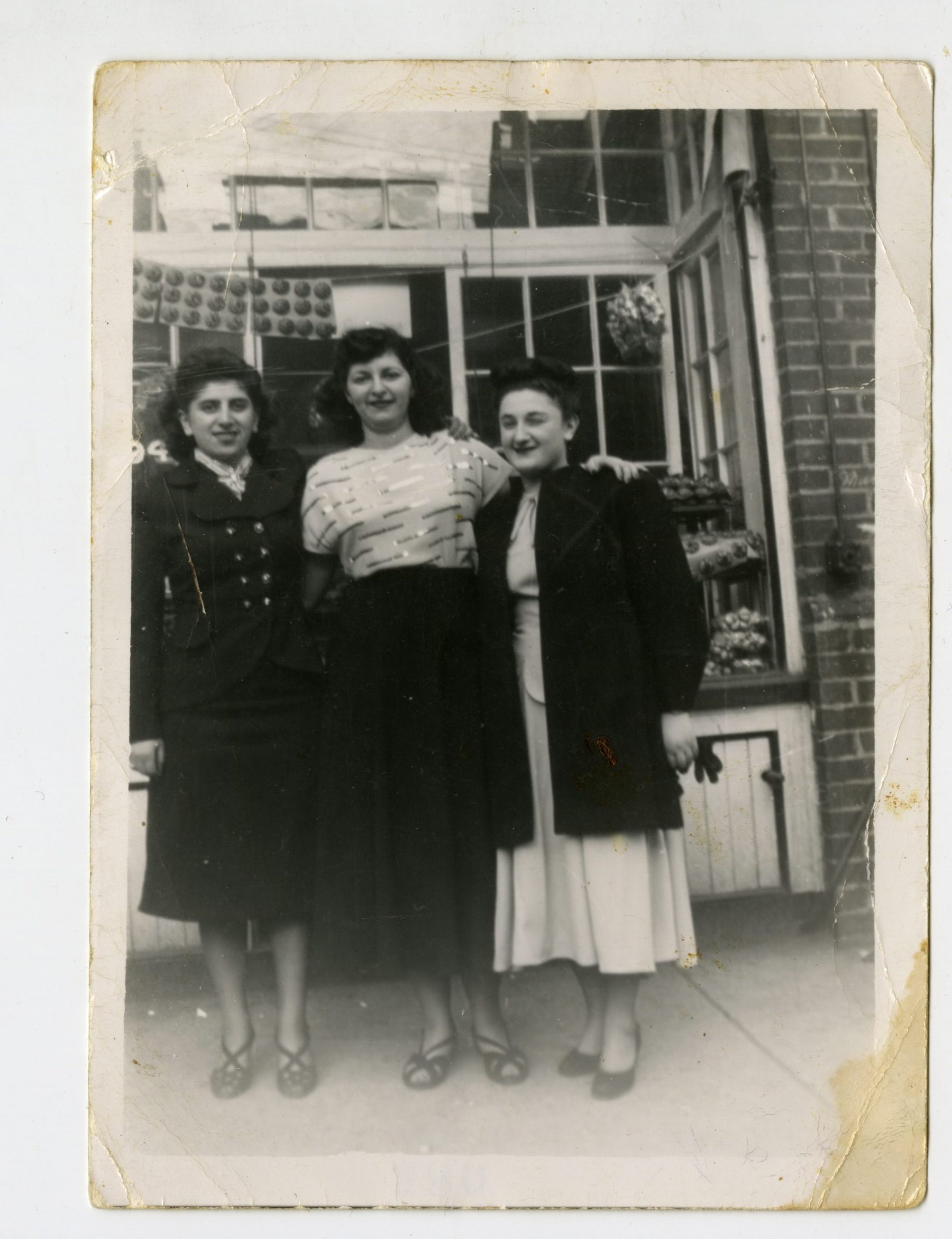 Sandy Shabinsky, Katie Lottman Grossman, and Ruth Berman (left to right) in the 1930s outside of Lottman's Bakery at its first location, 172 Baldwin Street. Sam Lottman opened the bakery in the 1920s, and his wife Emma worked alongside him. They lived on top of the bakery until 1947 and had three children, Jake Lottman, Katie Lottman Grossman, and Pearl Lottman Godfrey. Like many other Jewish families, they eventually moved north and out of the market.   OJA, accession 2013-11-2.