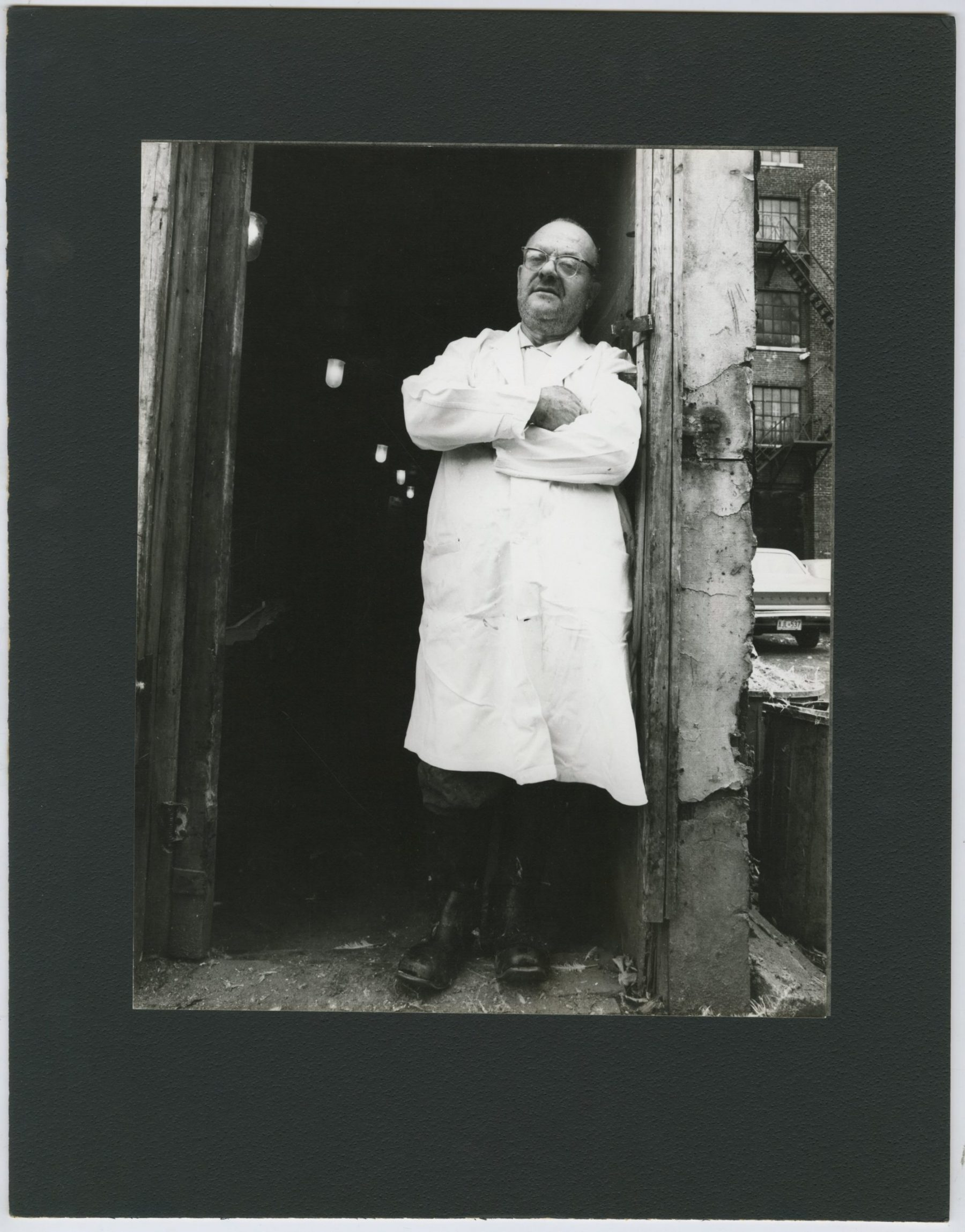 Chaim Light, a shochet, outside of a slaughterhouse behind the east side of Kensington Avenue and south of St. Andrews Street in the Summer of 1968. A shochet is a butcher certified to slaughter cattle and poultry in the manner prescribed by Jewish law.    OJA, item 4169.