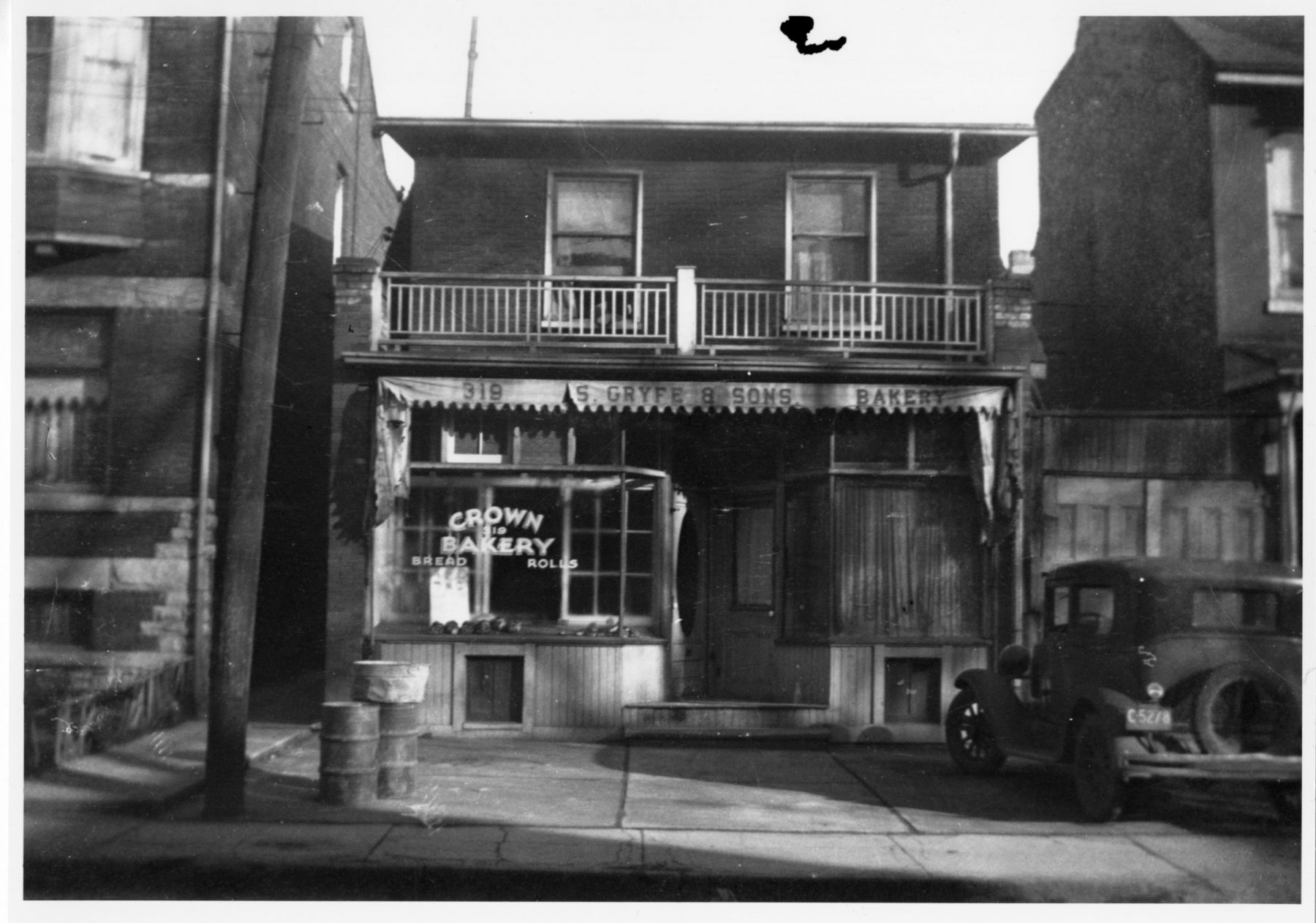 Crown Bakery storefront at 319 Augusta Avenue, ca. 1936. During this time the bakery was operated by the Gryfe family. The bakery was established in the market in 1925 and was famous for its bread and baked goods.   OJA, item 4521.