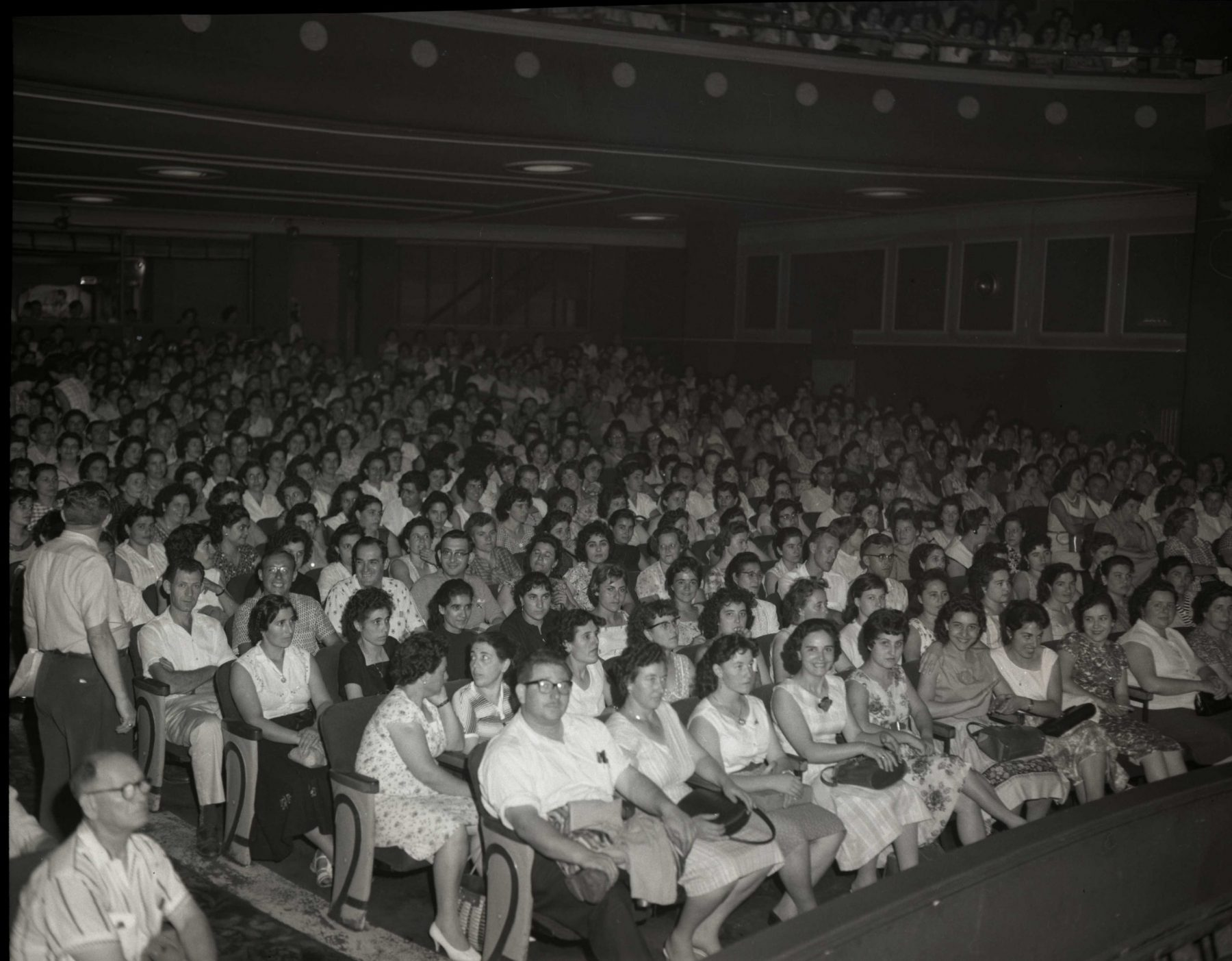 Garment workers in the Victory Theatre for the Cloakmakers' Union rally in September 1960.    OJA fonds 18, series 3, file 53, item 9.